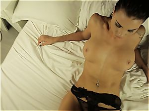 Alluring temptress performing a warm dance half naked