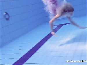 Proklova takes off swimsuit and swims under water