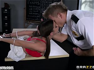 Policeman penalizes insatiable schoolgirl on the table