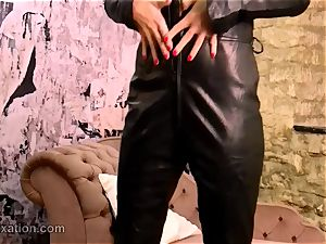 wonderful black-haired strips off leather catsuit romps toy