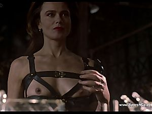 dark-haired Lena Olin in lingerie showcases off her small milk cans