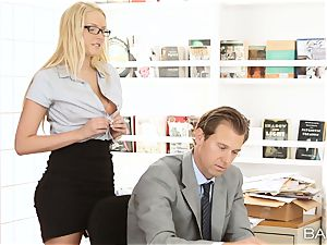 Vanessa cage arches over the desk and takes her bosses rod